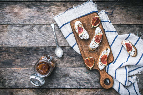 Healthy snacks with cheese and figs on wood board Stock photo © Arsgera