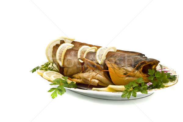 Dish - Bloated sheatfish with lemon and parsley Stock photo © Arsgera
