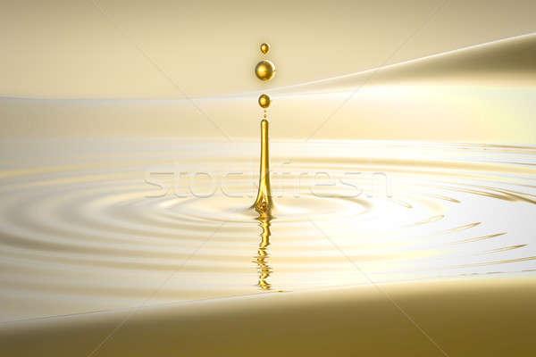 Splash złoty wody kropelka fale charakter Zdjęcia stock © Arsgera