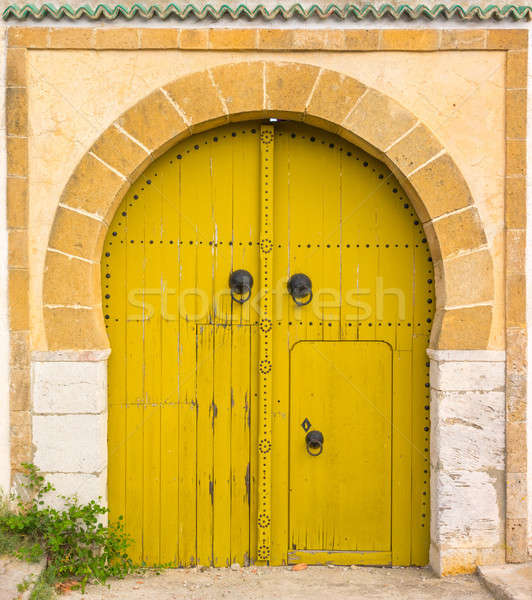 Yellow gates with door and ornament from Sidi Bou Said Stock photo © Arsgera