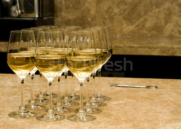 Glasses with white wine and opener on marble Stock photo © Arsgera