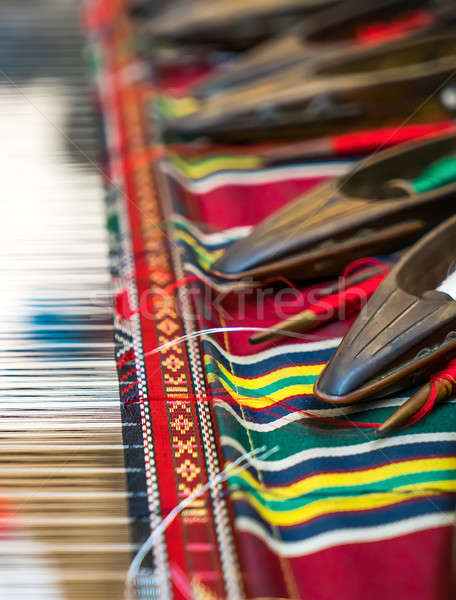 Weaving shuttles and colorful textile  Stock photo © Arsgera