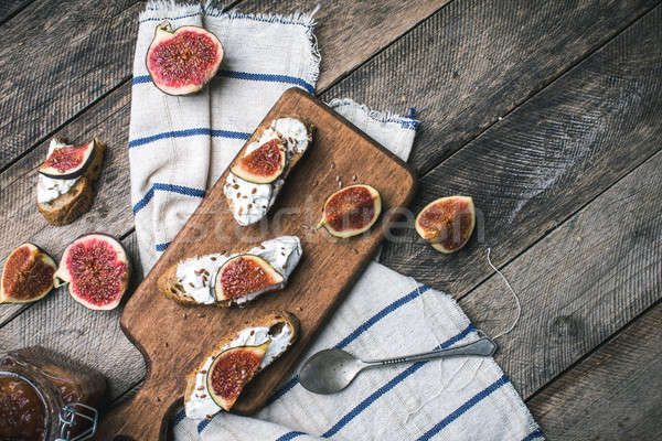 rustic style Bruschetta snacks with cheese and figs Stock photo © Arsgera