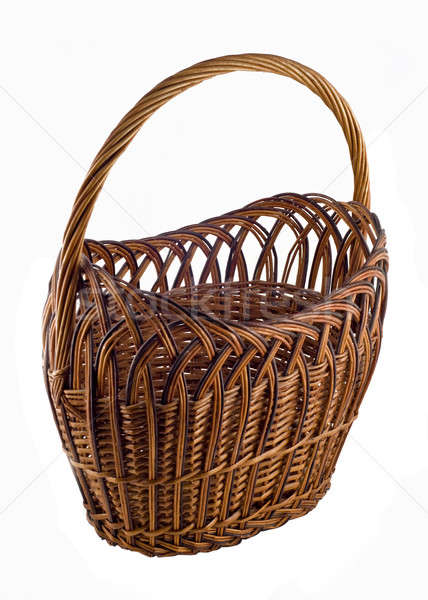 Brown woven basket over white Stock photo © Arsgera