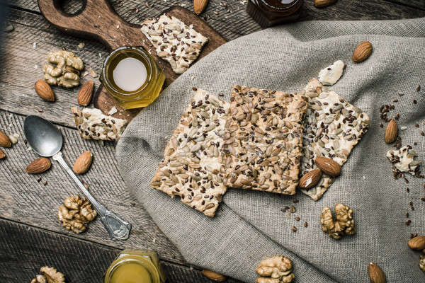 dietary Cookies with  honey and nuts on napkin and wooden table Stock photo © Arsgera