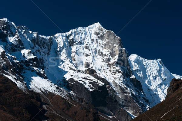 Snowbound mountain range and blue sky in Himalayas Stock photo © Arsgera