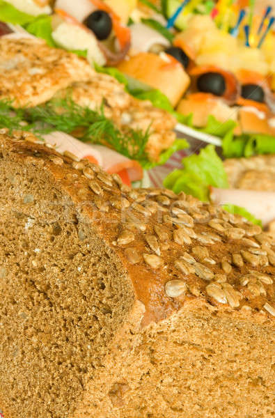Cut Bread with seeds, meat and canape  Stock photo © Arsgera