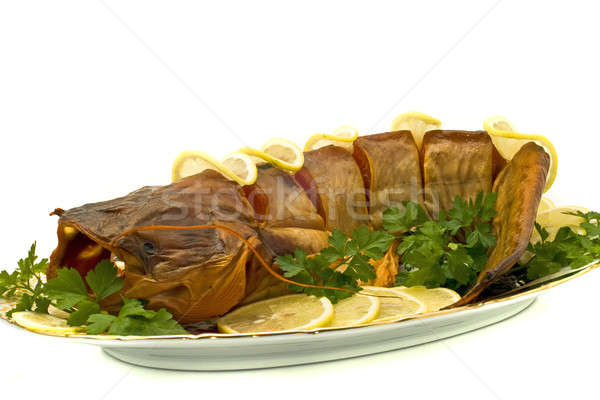 Tasty dinner - bloated fresh-water catfish on the plate Stock photo © Arsgera