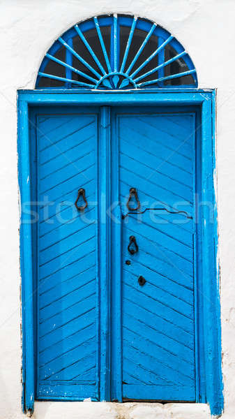 Blue wooden door with arch from Sidi Bou Said Stock photo © Arsgera