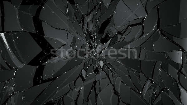 Pieces of splitted or cracked glass on black Stock photo © Arsgera