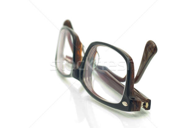 Modern plastic eyeglasses over white Stock photo © Arsgera