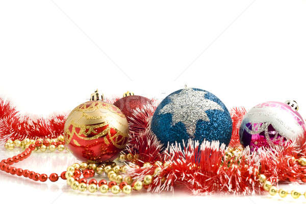 Beautiful Christmas decoration - colorful tinsel and balls  Stock photo © Arsgera