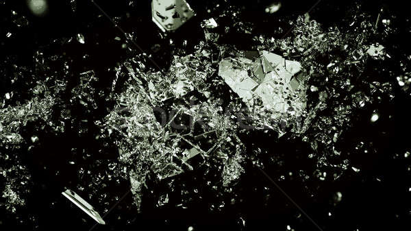 Pieces of splitted or broken glass on black Stock photo © Arsgera