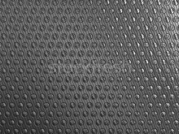 Carbon fibre background with round shapes Stock photo © Arsgera