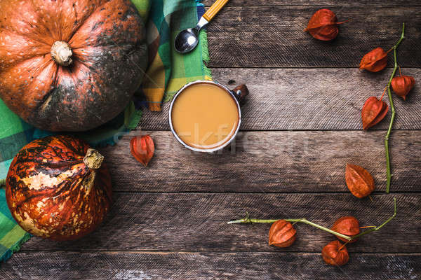 Pumpkins and soup with seeds and ground cherry on wood in Rustic Stock photo © Arsgera