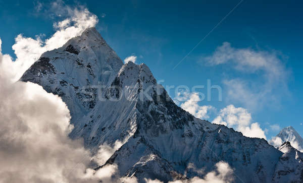 Mountain peaks and clouds in Himalayas Stock photo © Arsgera