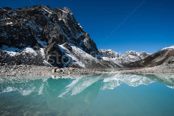 Mountains and Sacred Lake near Gokyo in Himalayas Stock photo © Arsgera