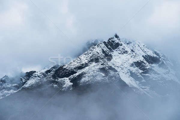 Snowed Mountain peaks hidden in clouds in Himalayas Stock photo © Arsgera