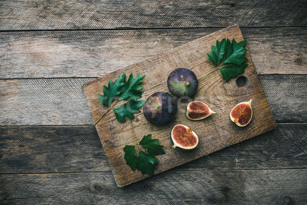 Tasty Figs on chopping board Stock photo © Arsgera