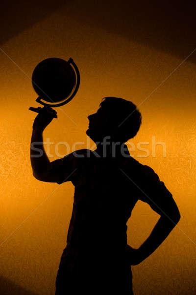 Back light - silhouette of man holding globe Stock photo © Arsgera