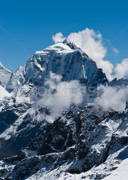 Taboche mountain peak and clouds viewed from Renjo pass Stock photo © Arsgera