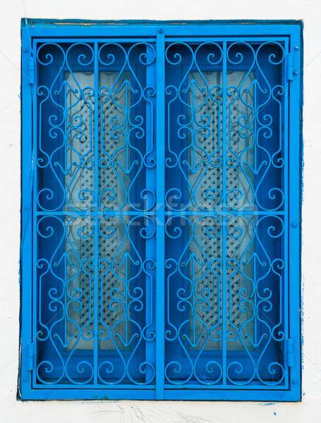 Traditional blue window from Sidi Bou Said in Tunisia Stock photo © Arsgera
