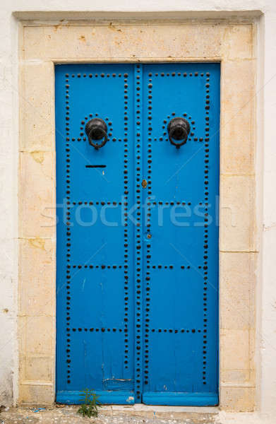Aged traditional door with from Sidi Bou Said in Tunisia Stock photo © Arsgera