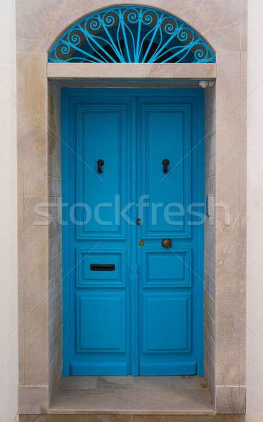 Blauw houten deur boog muur straat Stockfoto © Arsgera
