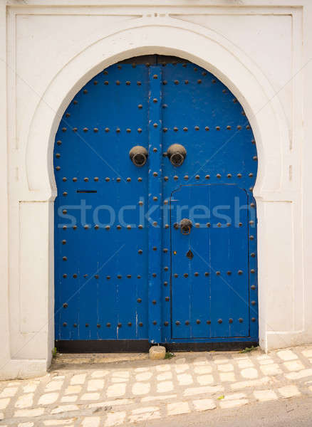 Blue door in Andalusian style from Sidi Bou Said Stock photo © Arsgera