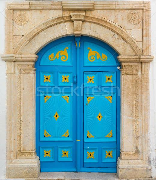 Blue door with ornament as symbol of Sidi Bou Said Stock photo © Arsgera