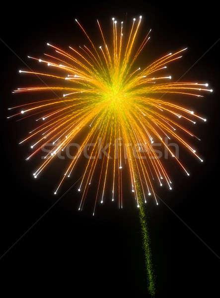 Stock photo: Festive orange fireworks at night