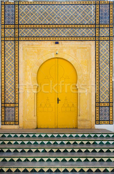 Traditional Tunisian door with tiles and ornament as symbol  Stock photo © Arsgera