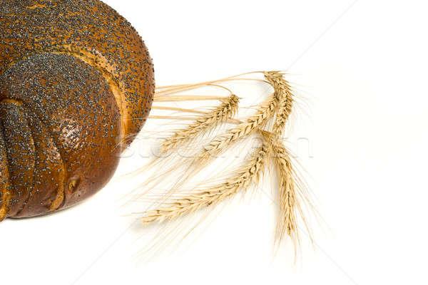 Tasty bagel with poppy seeds and wheat corn Stock photo © Arsgera