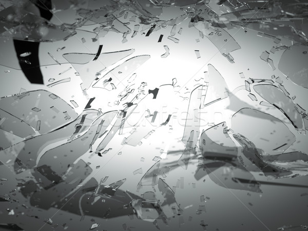 Shattered and breaking glass on gray with shallow DOF Stock photo © Arsgera