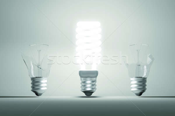 Idea and mistake or failure: illuminated bulb among two broken o Stock photo © Arsgera