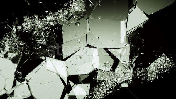 Pieces of smashed cracking glass on black Stock photo © Arsgera