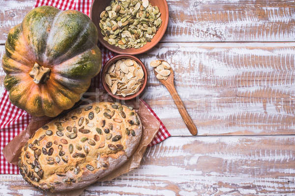 újonnan sült kenyér magok sütőtök fa asztal Stock fotó © Arsgera