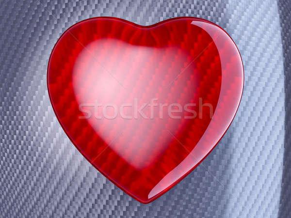 Red heart shape over carbon fibre Stock photo © Arsgera