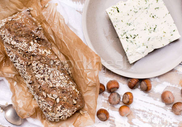 Bread with cheese and huzelnuts for breakfast on board Stock photo © Arsgera