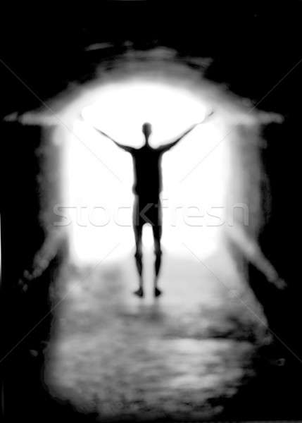 Human silhouette against the light of tunnel exit (shallow DOF) Stock photo © Arsgera