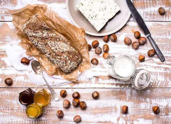 Bread with seeds huzelnuts and cheese on board Stock photo © Arsgera