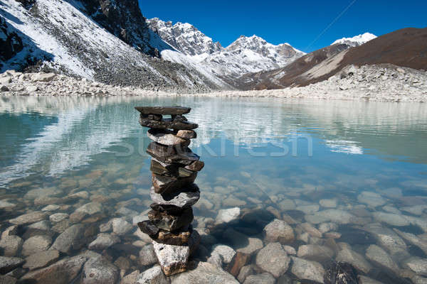 Harmony and balance: Stones and Sacred Lake near Gokyo Stock photo © Arsgera