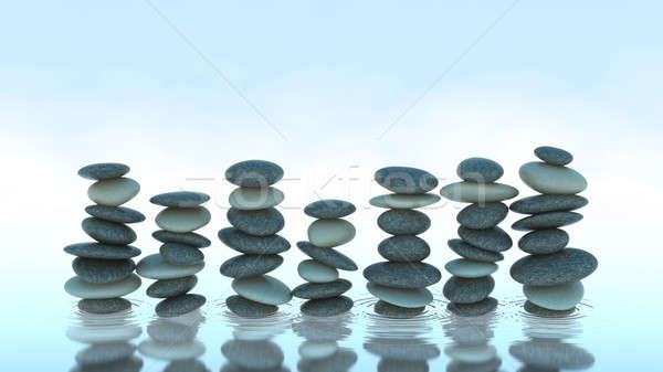 Seven Pebble stacks on water Stock photo © Arsgera