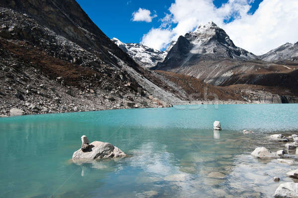 Pebble stacks and Sacred Lake near Gokyo Stock photo © Arsgera