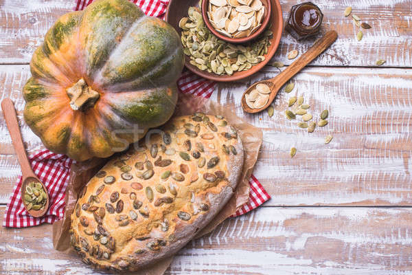 Newly baked bread with pumpkin and seeds wooden table Stock photo © Arsgera