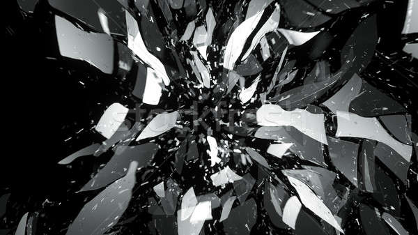 Broken pieces of glass on black with motion blur Stock photo © Arsgera