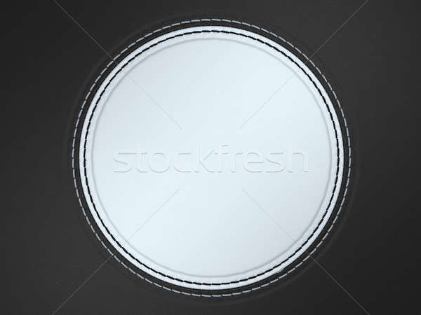 Black and white stitched circle shape on leather Stock photo © Arsgera