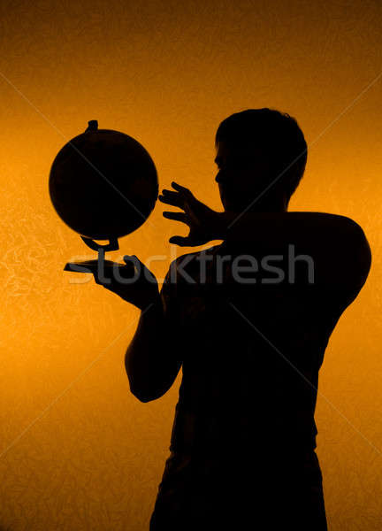 Discover the world - silhouette of man holding globe Stock photo © Arsgera