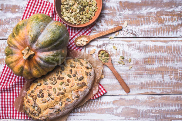White bread with pumpkin seeds on wooden table Stock photo © Arsgera