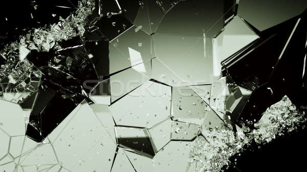 Shattered or cracked glass pieces on black Stock photo © Arsgera